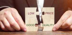 A businessman collects wooden puzzles with the words Low price - good quality